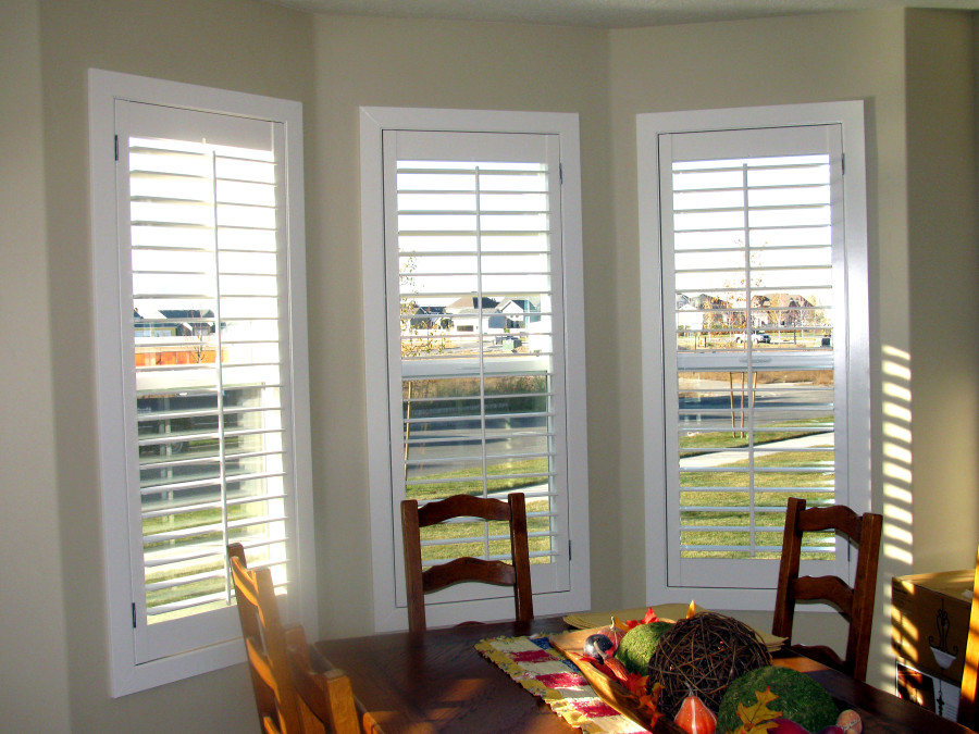 shutter window coverings on a kitchen bay window