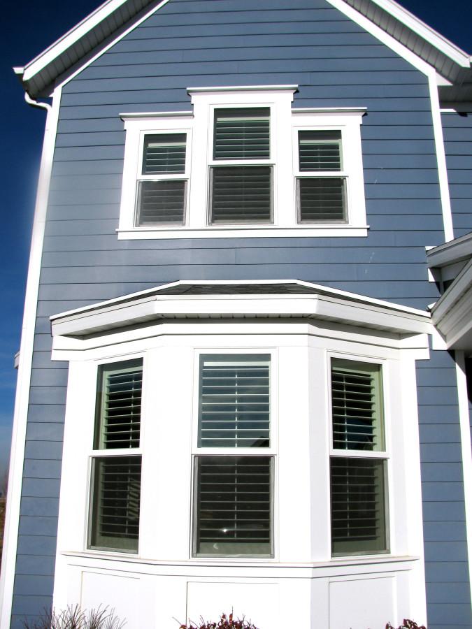 shutter window coverings on a bay window