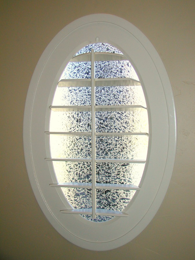 open oval window shutters